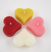 4 floating heart candles
