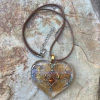 Heart shaped resin necklace on brown cord